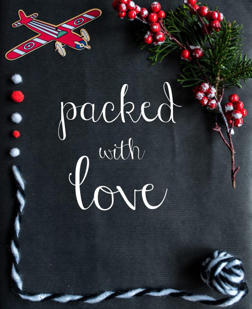 DIY Geschenke verpacken mit natürlichen Farben und Packpapier in Schwarz und roten Accessoires
