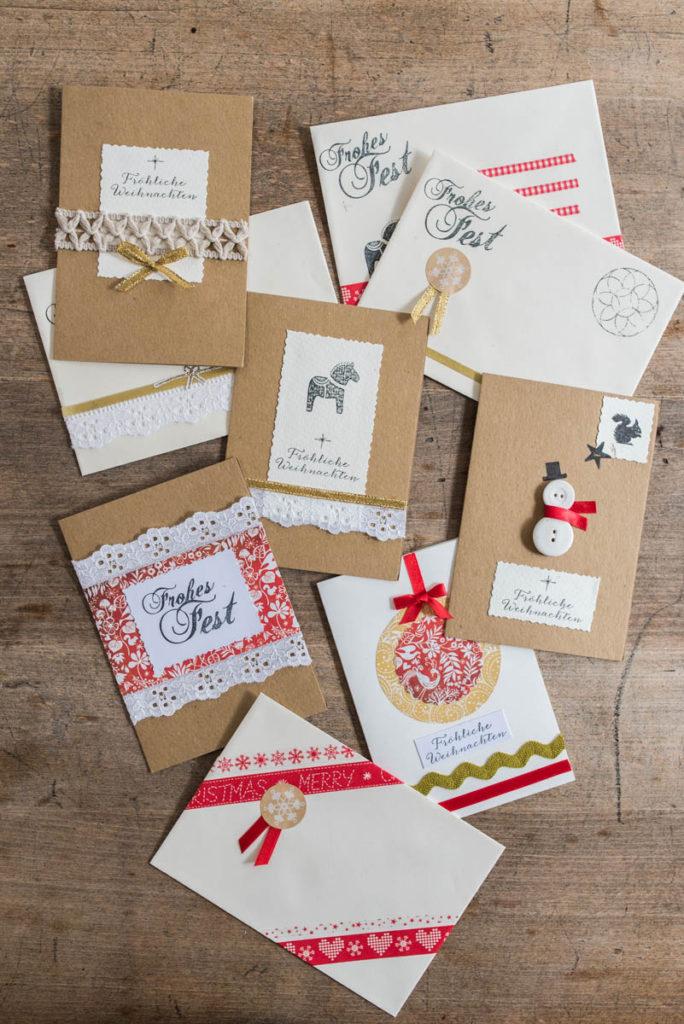 DIY Weihnachtskarten aus Papier mit Washi Tape, Glitzer, Aufklebern und Stempeln