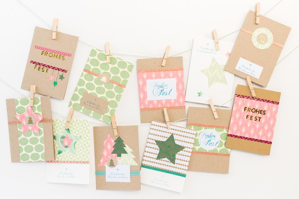 Ideen für selbst gemachte DIY Weihnachtskarten aus Kraft Papier und handgeschöpftem Papier in Mintgrün und Rosa mit Stempeln verziert
